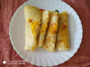 Kesariya Patishapta - Plattershare - Recipes, Food Stories And Food Enthusiasts